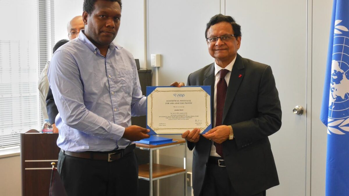 Graeme Risoni receives his certificate of completion from the UN SIAP Director, Ashish Kumar