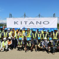 PM Soavare (c), Minister Agovaka (l) and Japanese Ambassador Yasuhiro Morimoto flanked by both local and foreign workers at the project site