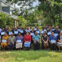 """The """"Gender mainstreaming in Agriculture and Rural Sector"""" Participants with the Permanent Secretary of MAL Ms. Ethel Frances (centre, front row), Director Women Development Division Ms. Vaela Devesi (third from left, front row), Trainer Ms. Pauline Soaki (first on the left, front row) and Director IPAM Mr. Solomon Manea (fourth from left, front row) and FAO FIRST rep Nichol Nonga (seventh from left, front row)."""